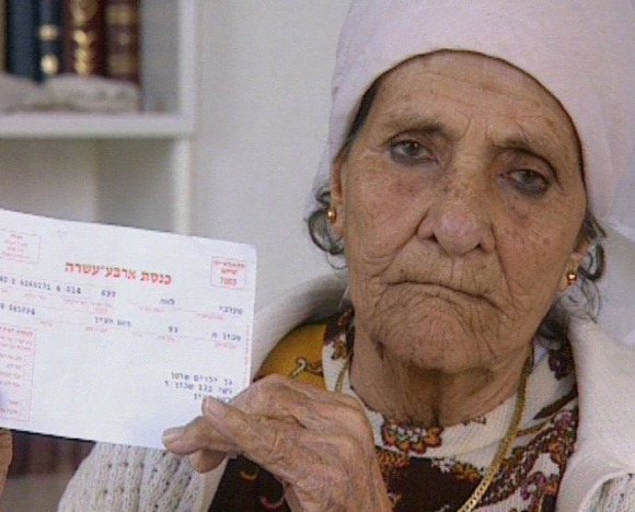 """A voter registration card for the 14th Knesset, addressed to a child who disappeared 20 years earlier, which arrived at his parents' home. (Screenshot from Tzipi Talmor's film, """"Down a one-way street,"""" which dealt with the kidnapped children.)"""