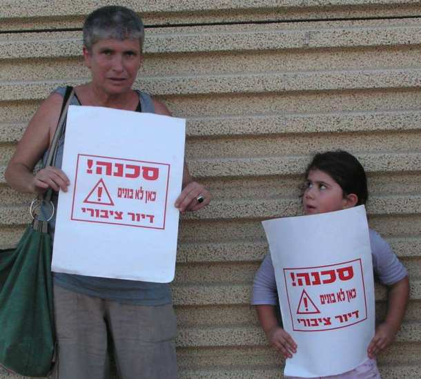 Housing rights activist Zehava Greenfeld and her friend. The problem in Israel is getting enough people to buy a building.