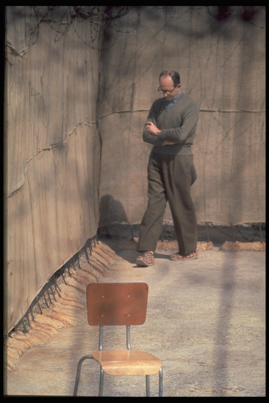 Adolf Eichmann paces in the yard of his cell in Ramle Prison, Israel, April 21, 1961(Photo: John Milli/GPO)